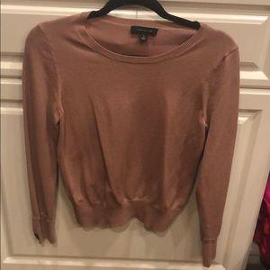 Tan, form fitting sweater
